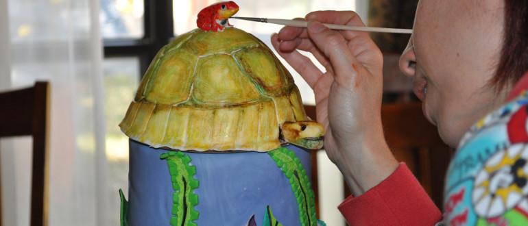 Painting fondant poison dart frog cake